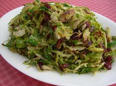 Alton Brown's Brussels Sprouts with Pecans & Cranberries. This is my absolute favorite way to eat brussels sprouts. So yummy! Brussel Sprouts Cranberries, Shaved Brussel Sprouts, Shredded Brussel Sprouts, Brussel Sprout Salad, Brussels Sprouts, Dried Cranberries, Vegetable Side Dishes, Vegetable Recipes, Vegetarian Recipes