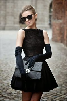 Attractive Black MIni Evening Dress with Long Gloves, Glasses and Fashionable Handbag