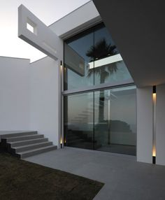 Private residence,  France, high glass doors and beautiful outdoor lighting _