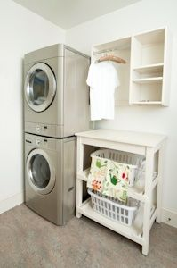 Loving the stackable front loaders to save more space. And the folding table with laundry basket storage underneath  | followpics.co