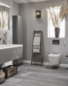 Styled by Malmo & Moss. Bringing the ultimate wellbeing experience to the bathroom, the elegant AquaClean Sela shower toilet offers an unmistakable feeling of freshness with its gentle, oscillating spray and cutting-edge smart toilet features. Simple Bathroom, Modern Bathroom Design, Bathroom Interior, Neutral, Wet Rooms, Loft Spaces, Modern Rustic Interiors, Minimalist Design, New Homes