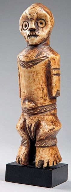 Africa | Statuette from the Lega people of DR Congo | Ivory