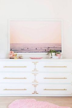 7 Color Combos Designers Swear By – The Evans Edit - Blush pink and gold - California pink surf prink, millennial pink fluffy rug, white modern campaign chest dresser with gold pull hardware.