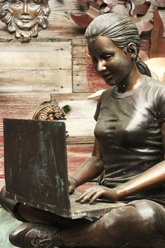 love this statue of girl on computer but would like one with girl and book