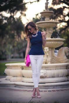 sunset sparkle, white pants, blue shirt and stand-out necklace