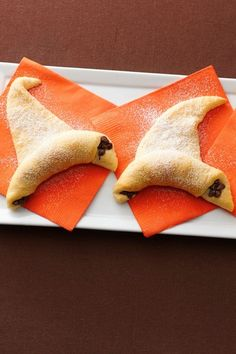Easy to make Halloween Wicked Witch hats. Crescent rolls and chocolate, how can you go wrong?! These delicious treats will be swept away within minutes. So Yummy!