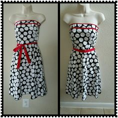 Strapless Sundress Cutest Sundress! Black and white polka-dot with red trim at bust and red tie belt.  Can be tied in front or back. Elastic at top of dress on the back. Zips in back. Size 3.  97% Cotton 3% Spandex Speechless Dresses