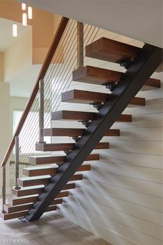 Stair & Railing Remodel Done Right-Walnut treads with a clear coat create an open-concept look in this contemporary home. The sleek mission-style handrail pairs with surface-mount posts to provide safety and stability that will last for years to co Metal Stairs, Painted Stairs, Floating Staircase, Modern Staircase, Spiral Staircases, Interior Stair Railing, Home Stairs Design, Stair Lighting, Stairs Architecture