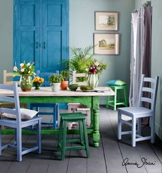 This bright and sunny dining room was brought to life with a range of colours from the Annie Sloan palette. The walls were painted with Wall Paint in Duck Egg Blue and the furniture in a range of Chalk Paint® colours.  Soft furnishings and curtains were made from Annie Sloan Coloured Linens. With so many colours combined, the scheme is held together by a focus on greens and blues, as well as pops of pale pinks and lilacs.