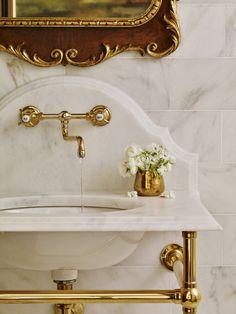 Vintage inspired brass faucet. Installed in this JackBilt home's powder bath