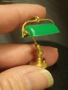 a miniature period reading lamp for my dollhouse library - painted hook plus Femo do (?) shade | Source: