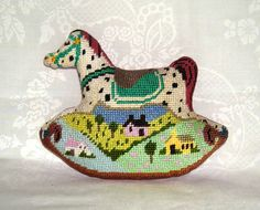 Needlepoint ornament of a rocking horse.