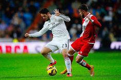 Francisco Roman Alarcon alias Isco (L) of Real Madrid CF competes for the ball with Joaquin Jose Marin alias Quini (R) of Rayo Vallecano de Madrid during the La Liga match between Real Madrid CF and Rayo Vallecano de Madrid at Estadio Santiago Bernabeu on November 8, 2014 in Madrid, Spain.