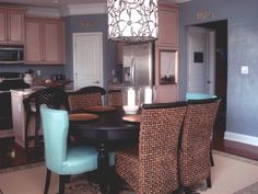 """My Great Room - Repost, My great room color flows into the breakfast room and kitchen. The color is """"island view"""" by Glidden. Custom chalkboard paint makes it easy to note grocery lists. Flower theme continued with large pendant light - my fav!  , Living Rooms Design"""