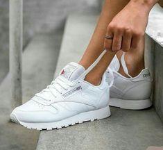 fc22195efa8da All white women s Reebok Classics sneakers. At TheShoeCosmetics all white  trainers are the canvas