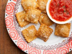 FRIED RAVIOLI  Olive oil  1 cup milk 1 egg 2 cups Italian-style bread crumbs  ravioli (about 24 ravioli)  Parmesan  1 jar marinara sauce, heated  olive oil in a large frying pan 2 inches. medium heat -325 deg    mix milk and egg and dip ravioli  to coat completely. dip ravioli in the bread crumbs.  cook till slightly golden (about 3min) Sprinkle with Parmesan and serve with warmed marinara sauce for dipping.