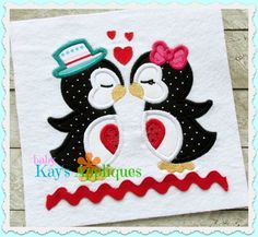 Kissing Penguins Applique -  A sweet little penguin couple. This Kissing Penguins design is a cute and easy design for Valentine's Day.