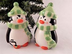 """Salt and Pepper Shakers, Holiday Tableware Brightly colored hand painted ceramic penguins Snug plastic plugs 3 1/2' h x 2 1/4"""" diameter One with two shakers holes, one with three Gently used for display only Charming Christmas ..."""