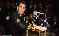 Star: Sgt. Elvis Presley was already a huge worldwide phenomenon - shown speaking at a press conference in 1960 when he returned from national service