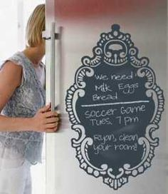 """Cool twist on traditional chalkboard, this decorative wall decal kit is easy to place, remove & reuse while adding a bit of fun and function. Huge, classy Rococo styled wall decal has a chalkboard finish for use anywhere you want to leave a note or make a list. Includes chalk. Non-toxic.31.5"""" x 18.5""""$36    Available at"""