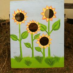 Sunflower themed corn hole for carnival party.