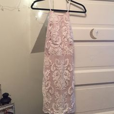 For love & lemons look alike dress NWT never been worn, Tan and cream design dress with tie in back. Bought at LF Size 8 but fits like a Small. No trades sorry. Not for love & lemons For Love and Lemons Dresses Mini