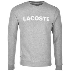 Lacoste Crew Neck Logo Sweatshirt In Silver Chine Grey Marl, A ribbed crew neck with a stretch ribbed design to the cuffs of the long sleeves and waistband. A large high shine rubberised Lacoste logo is on the chest in white with the signature embroidered Lacoste Crocodile logo badge situated on the lower right in white, grey and black. Soft fleecy interior. 82% Cotton And 18% Polyester. Quality And Style From Lacoste Jumpers And  Zip Tops Live Online UK.