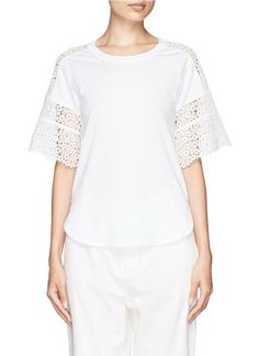 Casual silhouettes get a ladylike update on this Chloé rounded hem T-shirt. Trimmed with an exquisite eyelet guipure lace at the sleeves and shoulder seam, this piece will uphold an elegant profile on relaxed days.