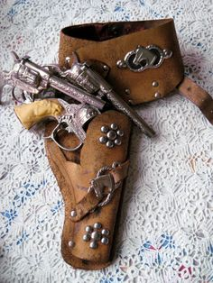 Wild Bill Hickock and Young Bill Hickock cap guns and cowgirl belt and holster, circa 1954