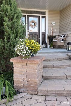 Container gardening idea: Add an urn filled with trailing flowers to each side of your home's front steps for great curb appeal!