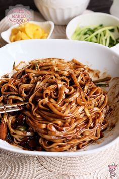 Jjajangmyeon (Korean Black Bean Sauce Noodles) ½ head Chinese cabbage – chopped 1 carrot – diced 1 potato – diced 1 medium yellow onion – diced 2 cloves garlic – minced 23tbsp Korean black bean paste ½ tsp salt 2 tbsp sugar 1 tbsp soy sauce Salt & pepper 1 cup (250 ml) water 1 tbsp corn starch + 1 tbsp water (to thicken sauce) Cooking oil Kalguksu / Wheat noodles (or fresh wheat noodles) Danmuji (yellow pickled radish) Japanese cucumber – julienne Rice vinegar