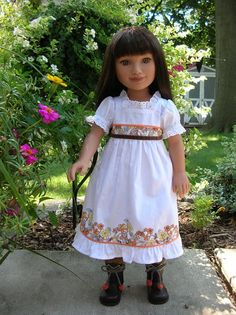 Gia, a Karito Kids doll in a lovely trimmed white dress!