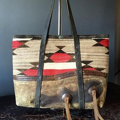 Navajo tote with vintage chaps leather base and cowboy conchos
