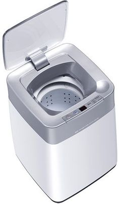 """""""The 26 x 28 x 38 cm compact washing machine is about the size of a medium sized kitchen waste bin """"  pretty awesome for apartments"""
