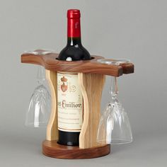 Resultado de imagem para wood wine glass holder over a wine bottle Wine Bottle Glass Holder, Wine Glass Holder, Wine Holders, Wine Bottles, Wooden Wine Holder, Wood Wine Racks, Wine Rack Design, Wine Craft, Woodworking Projects That Sell