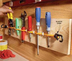 Use elastic cords to make a portable tool organizer for chisels and other hand tools. Fasten one end of the cord to a 1x8 with an electrical staple, lay the cord straight without stretching it, then staple the other end. Add staples every 3 in. to create holders, leaving the staples just loose enough so the cord can still move. Then fasten the 1x8 to the wall.