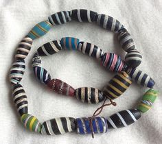 Antique African trade beads. Sometimes called 'barber poles'.