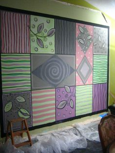 Canvas Floorcloth 98x10) being painted stretched on wall  Pam Marwede Is Pamdesign on facebook