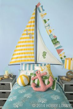 Ride a wave of style with an oh-my-wow piece like this cool sailboat headboard. To make it, we mounted duck cloth on a frame constructed from a curtain rod and a pair of painted dowels. What an adorable idea! Nautical Nursery, Nautical Home, Nautical Headboard, Nautical Flags, Nautical Pillows, Casa Kids, Ideas Dormitorios, Deco Kids, Beach House Decor