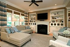Love the fireplace and the built ins.  I like that the furniture does not directly face the focal points