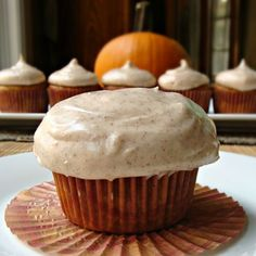 Pumpkin Cupcakes with Cinnamon Cream Cheese Frosting. Perfect for Fall! Yes please