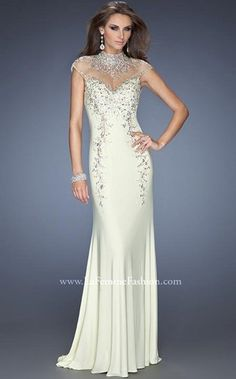 Stunning sweetheart, fitted jersey gown with a high neckline and cap sleeves comprised of net, by La Femme