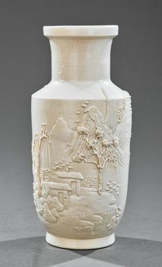 Chinese White Glazed Pottery Rouleau Vase, probably early-to-mid 19th c., finely molded and carved with garden scene in mountainous landscape, base with Wang Bing Rong Zho mark, h. 8 in