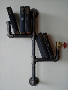 Industrial Vertical Pipe Shelf. What a great idea for the bathroom or office!