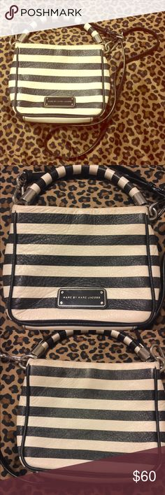 """Marc Jacobs Cross-body Bag 100% Authentic Marc by Marc Jacobs """"Too Hot To Handle"""" Mini Crossbody bag in used condition. Black/white striped. Light fading and slightly dirty, really just needs to be cleaned by a professional or with professional leather cleaning products. 100% Cow leather. Still has a lot of life left in it! Beautiful bag, just ready for something different. Price is firm. Marc by Marc Jacobs Bags Crossbody Bags"""