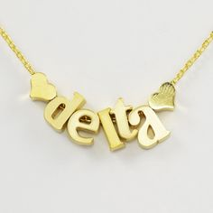 "Necklace for the sisters of Tri Delta. Lowercase letter beads spell ""delta"" and feature cute heart spacer beads. Available in silver, gold or rose gold."