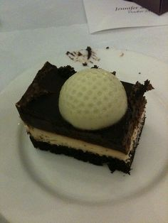 Mold a golf ball out of chocolate and put it on a brownie or other dessert for a golf tournament.
