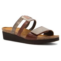 Show up in your casual best with the Naot Nancy open-toe slide. This women's sandal has a premium leather upper with inset elastic for easy flex. The suede-covered, shock-absorbing cork and natural latex cushioned footbed manages moisture and encourages correct posture.