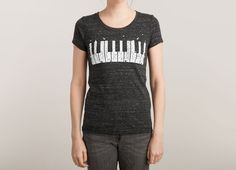 PIANO SKYLINE Design by Lawrence Villanueva / Super soft blend of cotton, polyester, and rayon combines irresistible comfort, flattering shape, and unique texture for one heck of a tee. Relaxed, retro, and effortlessly stylish, the tri-blend reinvents your favorite designs with vintage vibes.