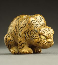 Sekiran (Japan, circa 1800 - circa 1875)   Crouching Tiger, mid- to late 19th century  Netsuke, Bamboo with inlays. LACMA